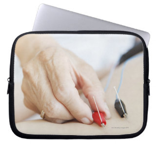 Asian woman (70-75 years old) putting red and computer sleeve