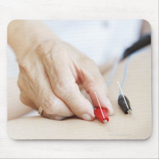 Asian woman (70-75 years old) putting red and mouse pad