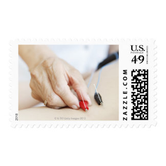Asian woman (70-75 years old) putting red and stamp
