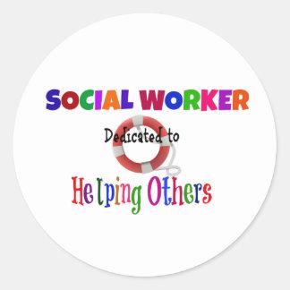 Asistente social dedicado a ayudar otras pegatina redonda