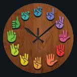 "ASL Woodgrain Large Clock<br><div class=""desc"">ASL sign language hands clock,  with hands in color wheel colors,  on a woodgrain faux finish background.</div>"