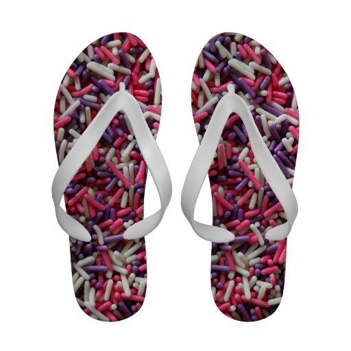 Asperja las sandalias del flip-flop