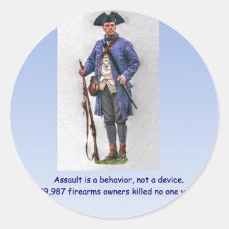 ASSAULT IS A BEHAVIOR NOT A DEVICE CLASSIC ROUND STICKER