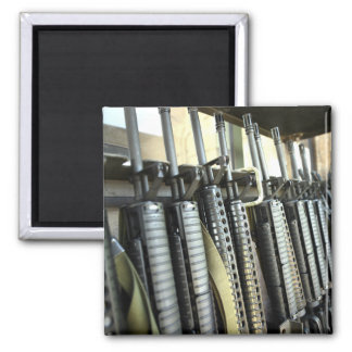 Assault rifles stand ready on the weapons rack refrigerator magnet