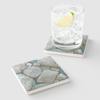 ASSEMBLAGE OF DIFFERENT SHAPED AND SIZES OF STONES STONE COASTER