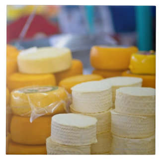 Assorted cheeses tile