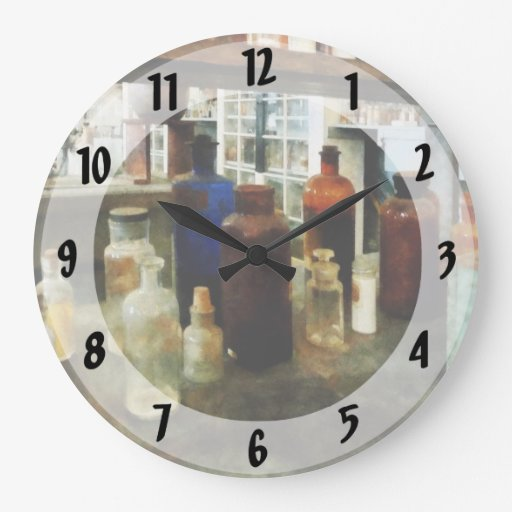 Assorted Chemicals in Bottles Wall Clocks