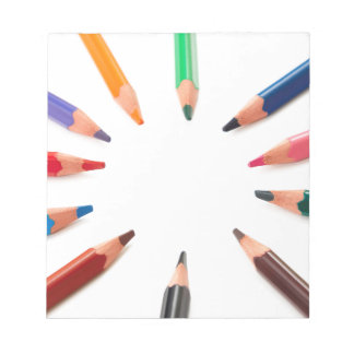 Assorted  colored pencils in a circle notepad