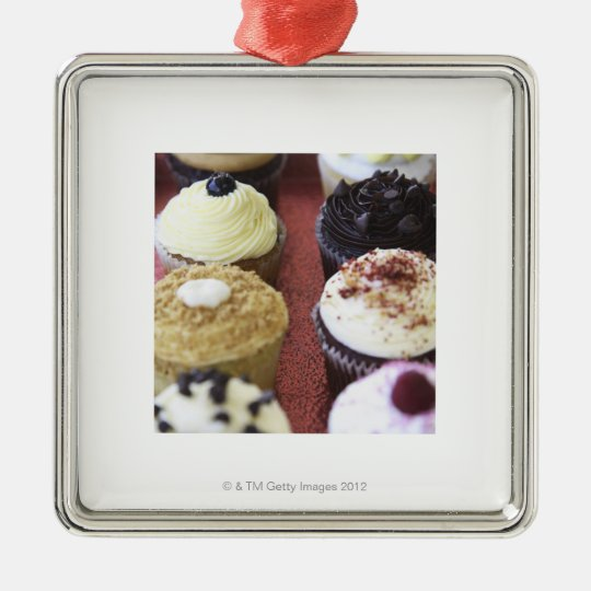 Assorted cupcakes metal ornament