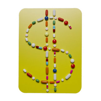 Assorted pills creating dollar symbol rectangular photo magnet