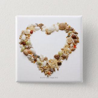 Assorted seashells form heart shape button