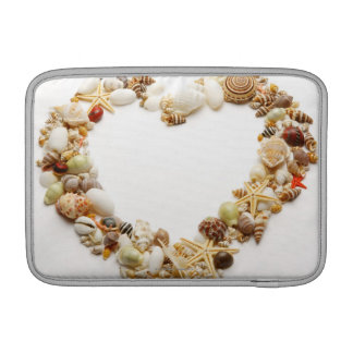 Assorted seashells form heart shape MacBook sleeve