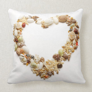 Assorted seashells form heart shape pillow