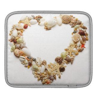 Assorted seashells form heart shape sleeve for iPads