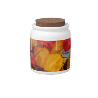 Assortment of colorful chilli peppers candy jar