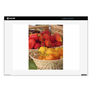 Assortment of colorful chilli peppers laptop skins