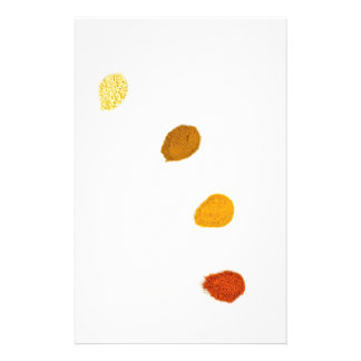 Assortment seasoning spices on porcelain spoons stationery