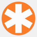 Asterisco - blanco en el naranja etiqueta redonda