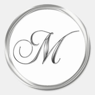 Astilla de la letra del monograma de M en el sello Pegatina Redonda