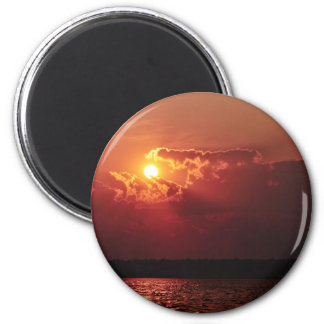 Astonishing Sun Setting behind some clouds Magnet