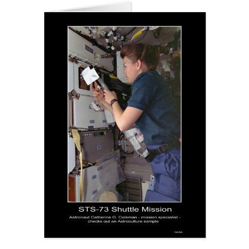 Astronaut Catherine G. Coleman checks Astroculture Card