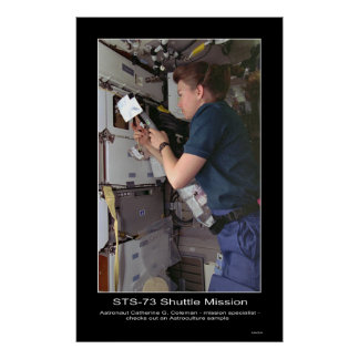 Astronaut Catherine G. Coleman checks Astroculture Poster