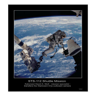 Astronaut David A. Wolf  transfers the Starboard Poster
