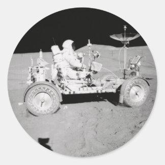 Astronaut driving Lunar Lander on the Moon Classic Round Sticker