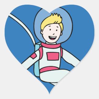 Astronaut Man Orbiting Earth Cartoon Heart Sticker