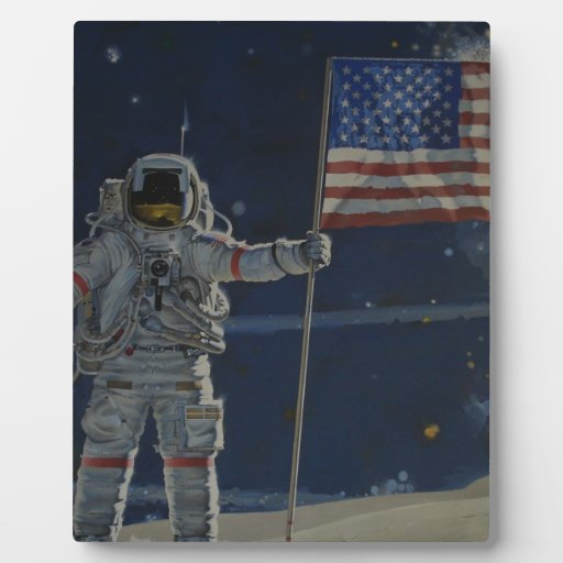 Astronaut on the Moon with American Flag Plaque