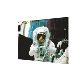 Astronaut Repairing Hubble Canvas Print