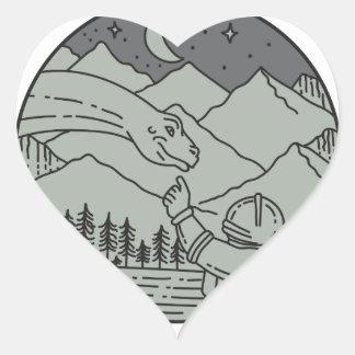 Astronaut Touching Brontosaurus Circle Mono Line Heart Sticker