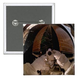 Astronaut uses a digital still camera button