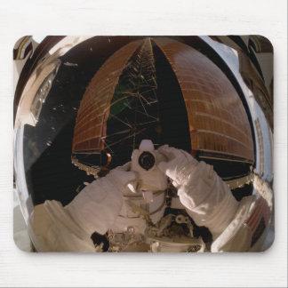 Astronaut uses a digital still camera mouse pad