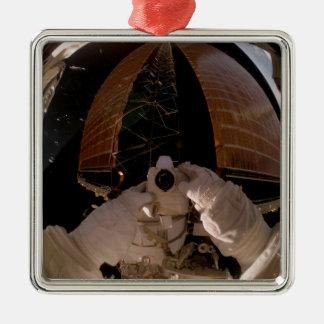 Astronaut uses a digital still camera square metal christmas ornament