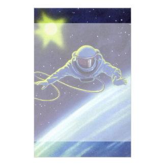 Astronauta de la ciencia ficción del vintage en un  papeleria
