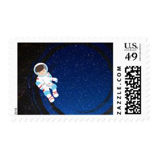 Astronauta en sello del espacio