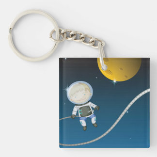 Astronauta joven del muchacho llavero cuadrado acrílico a una cara