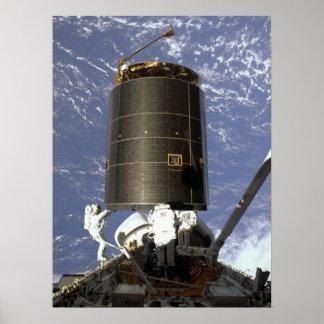 Astronauts capture and repair INTELSAT VI (STS-49) Poster