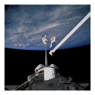 Astronauts conduct spacewalk above Discovery Poster