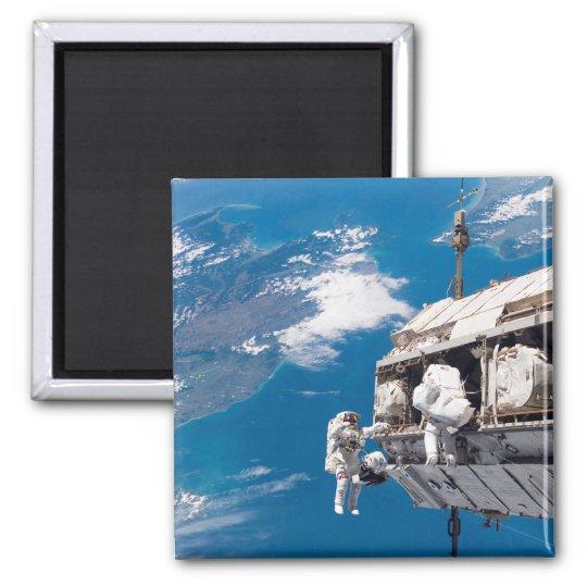Astronauts participate in extravehicular activi 2 magnet