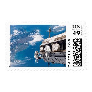 Astronauts participate in extravehicular activi 2 stamp