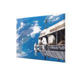 Astronauts participate in extravehicular activi canvas print