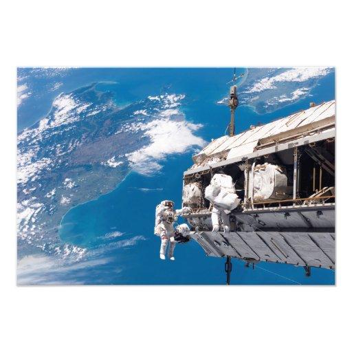 Astronauts participate in extravehicular activi photo print