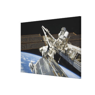 Astronauts perform a series of tasks canvas print