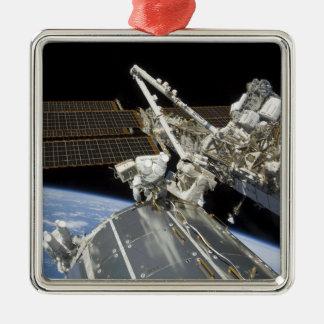 Astronauts perform a series of tasks metal ornament