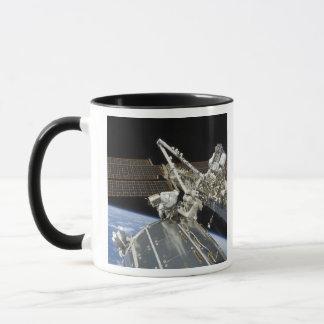 Astronauts perform a series of tasks mug