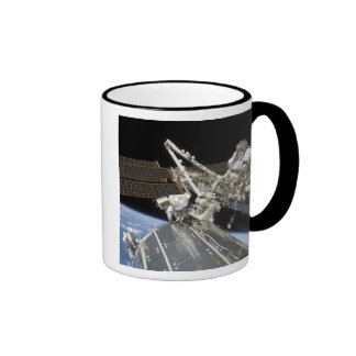 Astronauts perform a series of tasks mugs