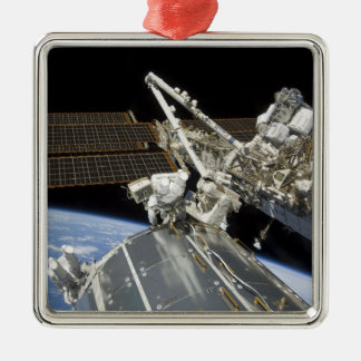 Astronauts perform a series of tasks square metal christmas ornament