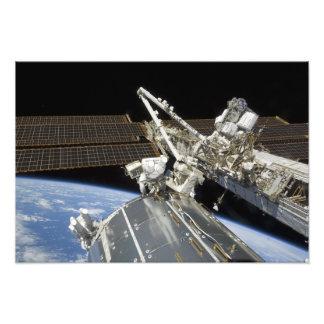 Astronauts perform a series of tasks photo print